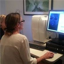 dr christine gould skin analysis with patient
